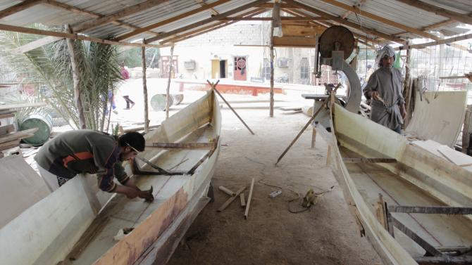 Iraqi workers build traditional boats in Basra, southeast of Baghdad
