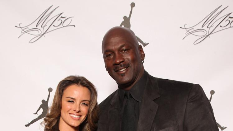 IMAGE DISTRIBUTED FOR JORDAN BRAND - Michael Jordan and his fiance, Yvette, are seen at the Jordan Brand party celebrating his birthday on Friday, February 15, 2013 in Houston, TX.  The Jordan Brand launched its Air Jordan XX8 in Houston on the same day.  (Photo by Omar Vega/Invision for Jordan Brand/AP Images)