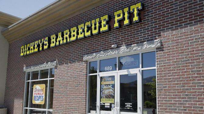 Dickey's Barbecue Pit is shown Monday, Aug. 18, 2014, in South Jordan, Utah. The Utah police agency investigating how iced tea that a woman drank at a restaurant ended up laced with an industrial cleaning solution is forwarding its findings to prosecutors to determine if anybody should be charged. Authorities have said an employee at Dickey's Barbecue in South Jordan unintentionally put the heavy-duty cleaner in a sugar bag, and a worker later mistakenly mixed it into the iced tea dispenser. (AP Photo/Rick Bowmer)