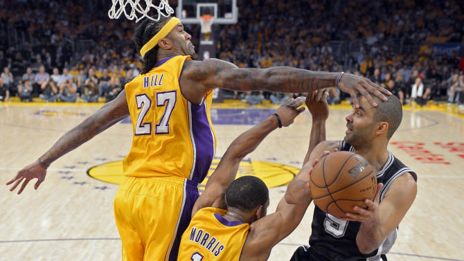 San Antonio Spurs guard Tony Parker, of France, goes up for a shot as Los Angeles Lakers center Jordan Hill, left, and guard Darius Morris defend during the second half in Game 3 of a first-round NBA basketball playoff series, Friday, April 26, 2013, in Los Angeles. The Spurs won 120-89. (AP Photo/Mark J. Terrill)