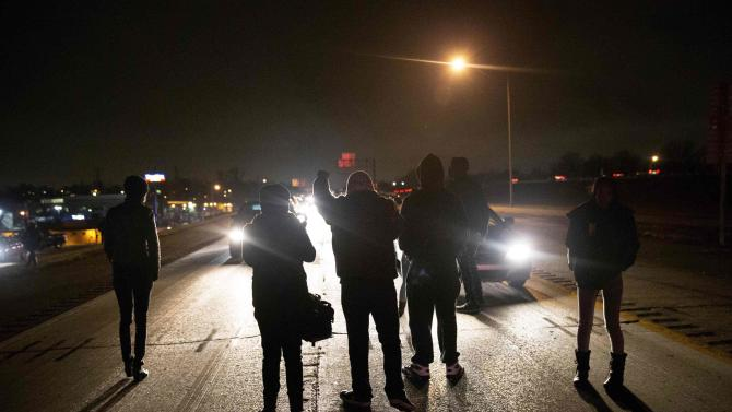 Protesters shut down Highway 170 after a man was shot by a policeman in Berkeley, Missouri