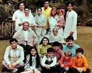 Article on Bollywood's first families. Families that have seen different generations of actors, directors and producers and have a stronghold in Bollywood. Mentions Bachchan family, Roshan, Deols, Mukherjees, Kapoors and Khans