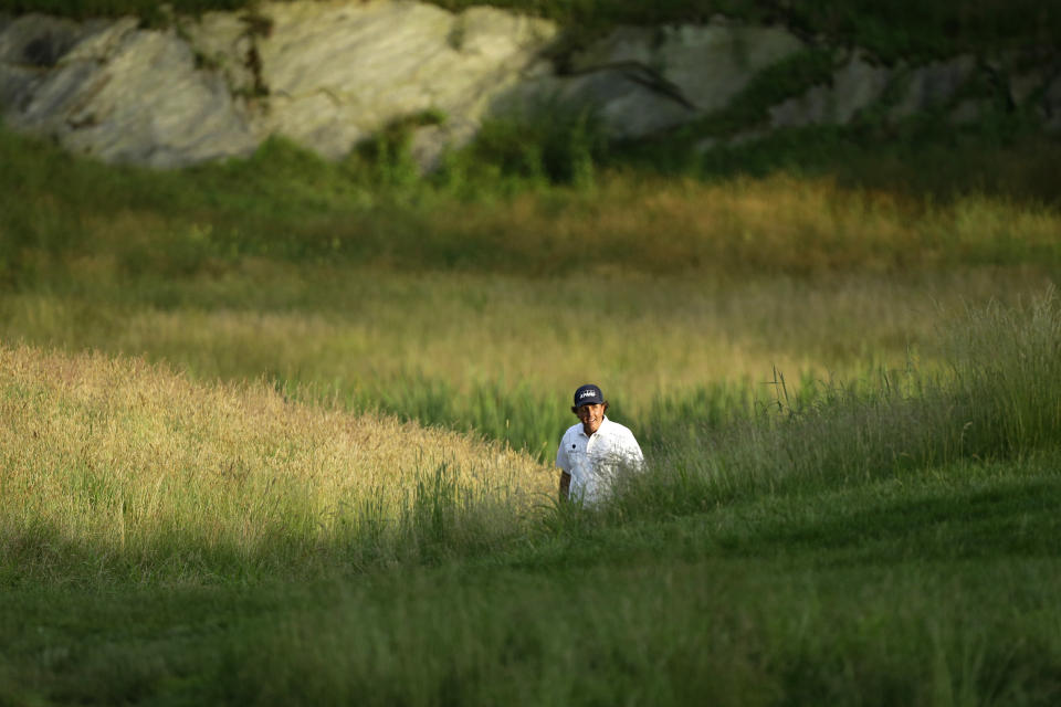 Phil Mickelson walks to the 17th green during the third round of the U.S. Open golf tournament at Merion Golf Club, Saturday, June 15, 2013, in Ardmore, Pa. (AP Photo/Julio Cortez)
