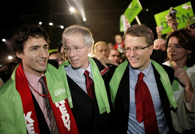 MONTREAL - DECEMBER 2: Newly elected Liberal Party Leader Stephane Dion (C) is congratulated by Gerard Kennedy (R) and Justin Trudeau (L) after delivering his victory speech at the Palais de congres i