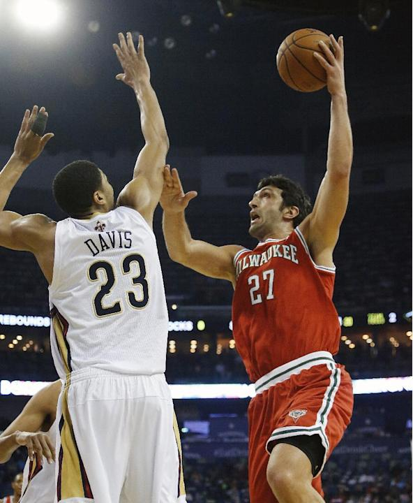 Milwaukee Bucks center Zaza Pachulia (27) shoots over New Orleans Pelicans forward Anthony Davis (23) during the first half of an NBA basketball game in New Orleans, Friday, March 7, 2014