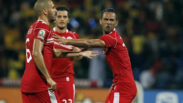 Tunisia's Saber Khalifa (R) celebrates his goal with teammates during their African Nations Cup quarter-final soccer match against Ghana at Franceville stadium February 5, 2012 (Reuters)