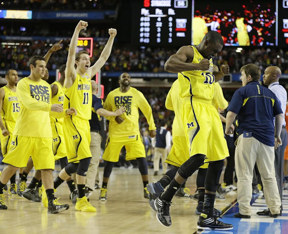 Michigan players react after the second half of the NCAA Final Four tournament college basketball semifinal game against Syracuse, Saturday, April 6, 2013, in Atlanta. Michigan won 61-56. (AP Photo/Charlie Neibergall)