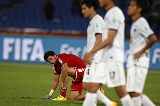 Mahmoud Trezeget of Egypt's Al Ahly reacts after his team lost their 2013 FIFA Club World Cup football match for fifth place against Mexico's Monterrey in Marrakech stadium
