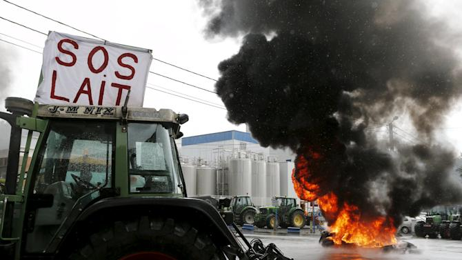 Tractors block the access to the milk processing factory Corman during a protest by Belgian dairy farmers against low milk prices in Bethane