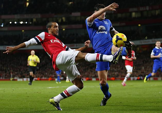 Everton's Barry challenges Arsenal's Walcott during their English Premier League soccer match at The Emirates in London