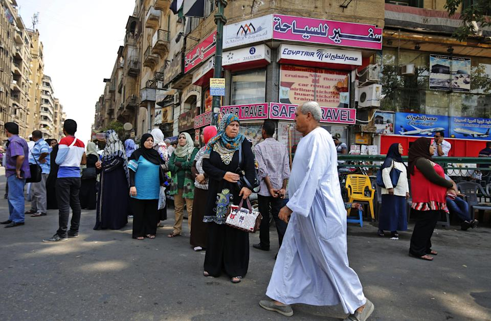 People walk in Tahrir Square in Cairo, Egypt, Tuesday, Sept. 10, 2013. While street violence and political unrest have engulfed Egypt since the military coup that ousted President Mohammed Morsi in July, Egyptians still try to go about heir daily lives. (AP Photo/Lefteris Pitarakis)