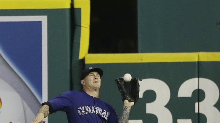Colorado Rockies right fielder Brandon Barnes catches a fly ball by Detroit Tigers' Nick Castellanos during the sixth inning of an interleague baseball game, Friday, Aug. 1, 2014, in Detroit. (AP Photo/Carlos Osorio)