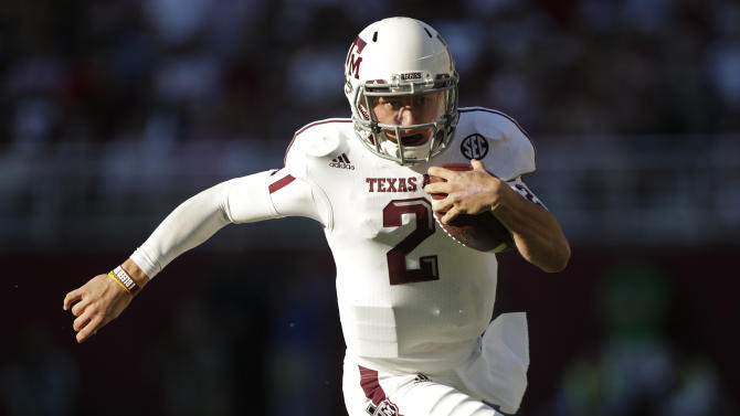 FILE - In this Nov. 10, 2012, file photo, Texas A&M quarterback Johnny Manziel (2) runs for a first down during the first half of an NCAA college football game against Alabama at Bryant-Denny Stadium in Tuscaloosa, Ala. In his Hill Country hometown of Kerrville, Texas, Johnny Football never would have been known by such a specific nickname.  Manziel's high school coach says Texas A&M's star quarterback could have been Johnny Baseball or Johnny Golf. (AP Photo/Dave Martin, File)