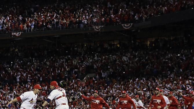 St. Louis Cardinals catcher Yadier Molina and Trevor Rosenthal celebrate after Game 6 of the National League baseball championship series against the Los Angeles Dodgers Friday, Oct. 18, 2013, in St. Louis. The Cardinals won 9-0 to win the series