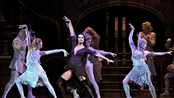 """In this theater image released by The Publicity Office, Brooke Shields portrays Morticia Addams, center, in a performance of """"The Addams Family,"""" in New York. The production will end its run on Dec. 31, 2011. (AP Photo/The Publicity Office, Jeremy Daniel)"""