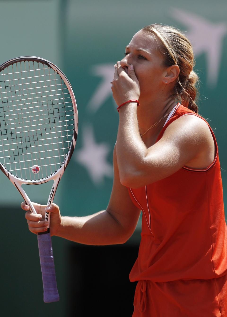 Slovakia's Dominika Cibulkova reacts as she plays Australia's Samantha Stosur during their quarterfinal match in the French Open tennis tournament at the Roland Garros stadium in Paris, Tuesday, June 5, 2012. Stosur won 6-4, 6-1. (AP Photo/Michel Spingler)