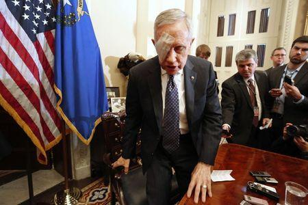 Reid departs at the end of a news conference in his office at the U.S. Capitol in Washington