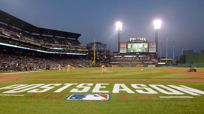 The MLB post season logo is on the first base line at PNC Park as the grounds crew prepares the field for the NL wild-card playoff baseball game between the Pittsburgh Pirates and the San Francisco Giants on Wednesday, Oct. 1, 2014, in Pittsburgh. (AP Photo/Don Wright)