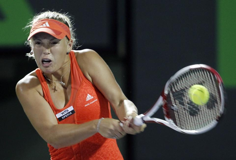 Caroline Wozniacki, of Denmark, returns to Serena Williams, of the United States, during the Sony Ericsson Open tennis tournament in Key Biscayne, Fla., Tuesday, March 27, 2012. (AP Photo/Alan Diaz)