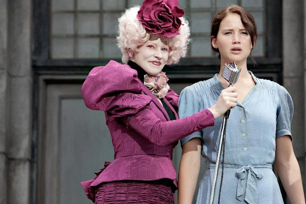 "In this image released by Lionsgate, Elizabeth Banks portrays Effie Trinket, left, and Jennifer Lawrence portrays Katniss Everdeen in a scene from ""The Hunger Games."" (AP Photo/Lionsgate, Murray Close"