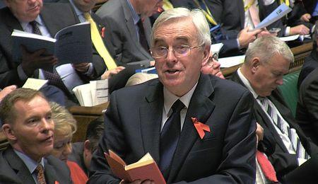 A still image from video shows Britain's shadow Chancellor of the Exchequer John McDonnell quoting from Mao's Little Red Book