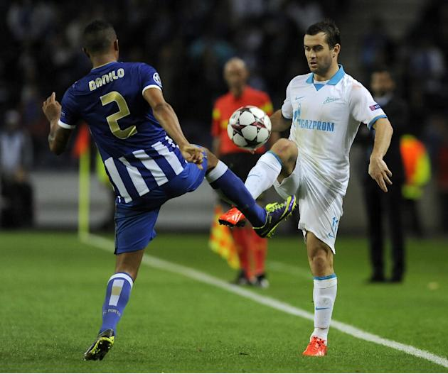 Zenit's Aleksandr Kerzhakov, right, vies with Porto's Danilo Silva, from Brazil, during the Champions League group G soccer match between FC Porto and Zenit Tuesday, Oct. 22, 2013, at the Dragao stadi