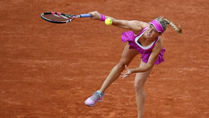 Eugenie Bouchard of Canada plays a shot to Kristina Mladenovic of France during their women's singles match at the French Open tennis tournament at the Roland Garros stadium in Paris