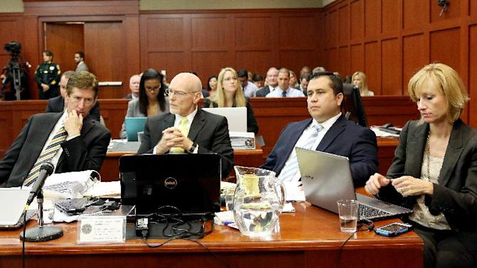 Defense attorneys, from left, Mark O'Mara, Don West and Lorna Truett, far right, listen to testimony with their client George Zimmerman, second from right, during Zimmerman's trial in Seminole circuit court in Sanford, Fla. Wednesday, June 26, 2013. Zimmerman has been charged with second-degree murder for the 2012 shooting death of Trayvon Martin.(AP Photo/Orlando Sentinel, Jacob Langston, Pool)