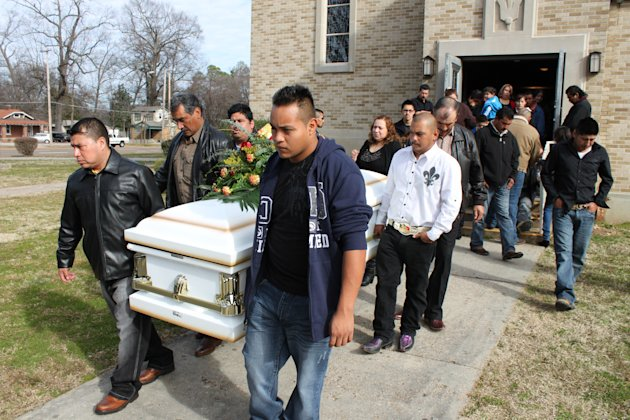 In this Jan. 25, 2013 photo, mourners carry the coffin of Rene Trejo from the St. Michael Catholic Church in Memphis, Tenn. Trejo, 28, worked hard as a bricklayer in Memphis, and loved soccer so avidly that he played on three different teams. But his sister-in-law says his plan was to move back eventually to his homeland of Mexico where he'd been sending money to help his impoverished mother open a restaurant. He was killed in a nighttime robbery attempt on Saturday, Jan. 19, 2013. From the biggest cities to the smallest towns, more than 31,000 people die of gunshot wounds in the U.S. each year, according to the Centers for Disease Control and Prevention - an average of nearly 87 people a day. (AP Photo/La Raza, Francisco Correa)
