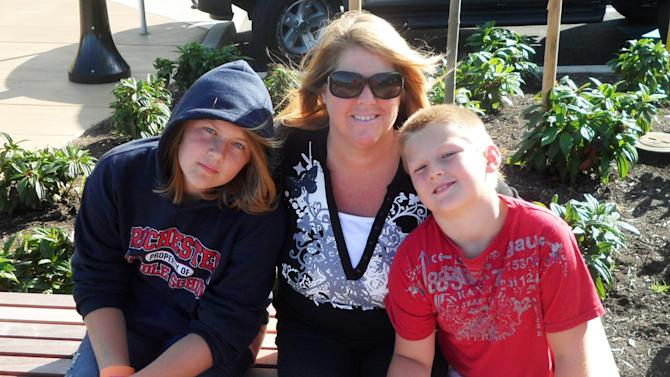 This August 2011 photo provided by the family shows Sarena Haskins, center, with her children, Hannah, 12, at left, and Hayden, now 8, in Olympia, Wash. Sarena Haskins is a regular user of marijuana for medical reasons, as allowed by state law. But she is opposed to a measure on Washington's Nov. 6 ballot that would legalize pot for recreational purposes, and advises Hannah not to experiment with it. (AP Photo/Kris Haskins)