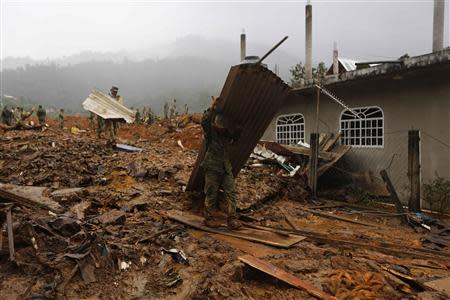 Soldiers work at the site of a mudslide in the village of La Pintada, in the Mexican state of Guerrero