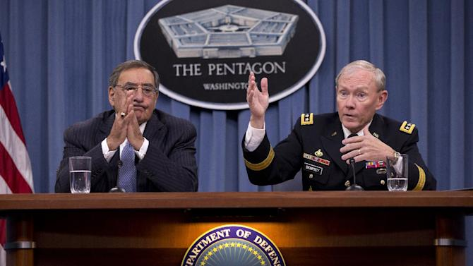 Joint Chiefs Chairman Gen.  Martin Dempsey, accompanied by Defense Secretary Leon Panetta, gestures during their joint news conference at the Pentagon, Thursday, Oct. 25, 2012. During the news conference, Panetta sais the U.S. military did not intervene during the attack on the U.S. Consulate in Libya last month because it was over before the U.S. has sufficient information on which to act.  (AP Photo/Carolyn Kaster)