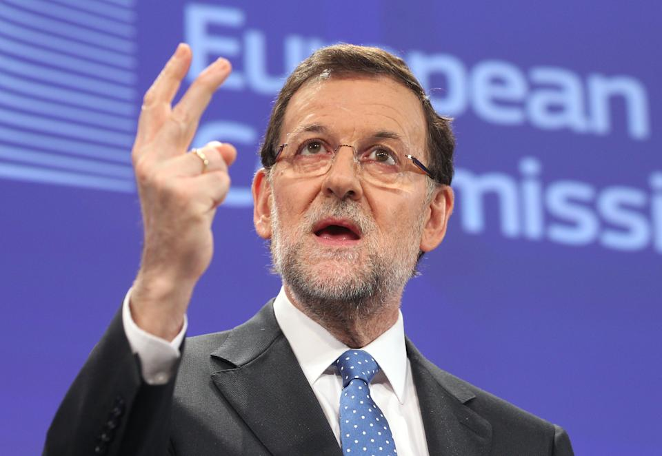 Spain's Prime Minister Mariano Rajoy, addresses the media after he met European Commission President Jose Manuel Barroso, at the European Commission headquarters in Brussels, Wednesday, June 5, 2013. Spain's Prime Minister Mariano Rajoy will meet various leaders at the European institutions. (AP Photo/Yves Logghe)