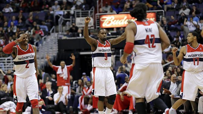 Washington Wizards guard John Wall (2), forward Martell Webster (9) and guard Garrett Temple (17) celebrate a 3-point shot in the second half of an NBA basketball game against the Los Angeles Clippers Monday, Feb. 4, 2013 in Washington. The Wizards won 98-90. (AP Photo/Alex Brandon)