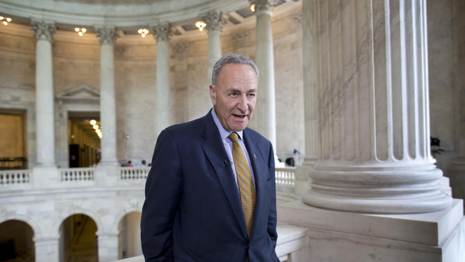 """FILE – In this May 6, 2013, file photo Sen. Chuck Schumer, D-N.Y., talks during a television news interview on Capitol Hill in Washington. Schumer is proposing legislation that would set additional rules for how leaks about government secrets are investigated. He said Sunday, May 26, 2013, on CBS' """"Face the Nation"""" that when the government is going to ask a news organization to divulge information it first must go to a judge. He says that judge would """"impose a balancing test"""" to determine which is more important, the government's desire to find the information or the robust freedom of the press. (AP Photo/J. Scott Applewhite, File)"""