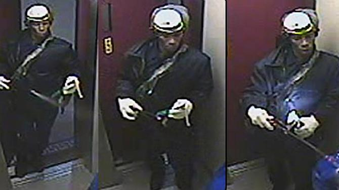 This Saturday, Dec. 17, 2011 surveillance photo provided by the New York Police Department shows a suspect wanted in connection with a homicide, in the Brooklyn borough of New York. A woman burned to death in the elevator of her Brooklyn apartment building Saturday afternoon after a man ambushed her, sprayed her with liquid and set her afire with a Molotov cocktail, police said. (AP Photo/New York Police Department)