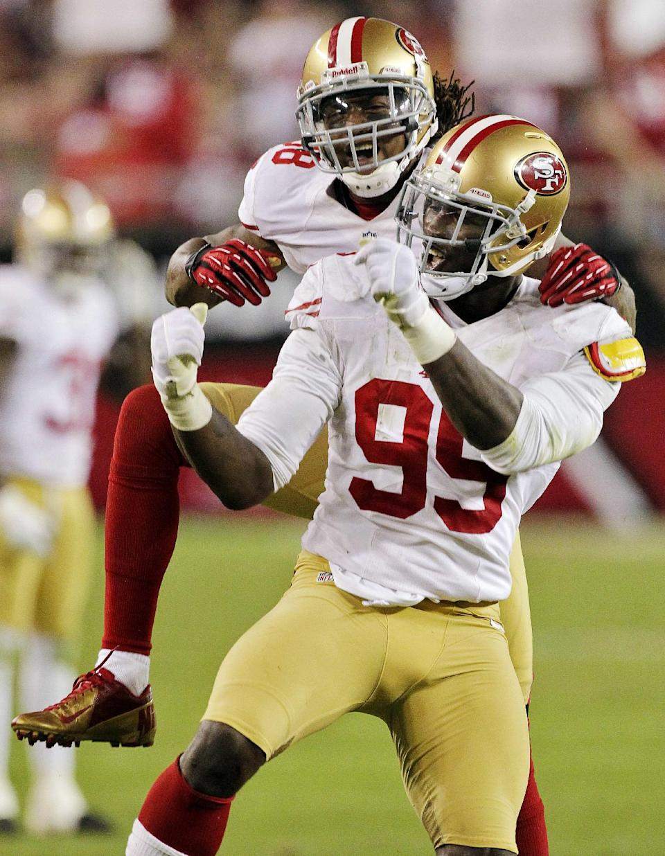 San Francisco 49ers outside linebacker Aldon Smith (99) celebrates his sack of Arizona Cardinals quarterback John Skelton with Parys Haralson during the second half of an NFL football game, Monday, Oct. 29, 2012, in Glendale, Ariz. (AP Photo/Matt York)