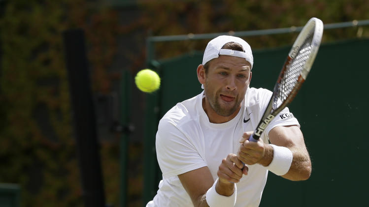 Lukasz Kubot of Poland returns to Adrian Mannarino of France during their Men's singles match at the All England Lawn Tennis Championships in Wimbledon, London, Monday, July 1, 2013. (AP Photo/Alastair Grant)