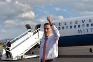 US Republican presidential candidate Mitt Romney gives a thumbs-up near his campaign plane in Weyers Cave, Virginia. Romney celebrated his debate coup with a surprise visit to a conservative conference in the Colorado city of Denver