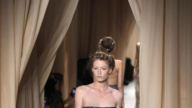 A model wears a creation for Valentino's Spring-Summer 2015 Haute Couture fashion collection presented in Paris, France, Wednesday, Jan. 28, 2015. (AP Photo/Christophe Ena)