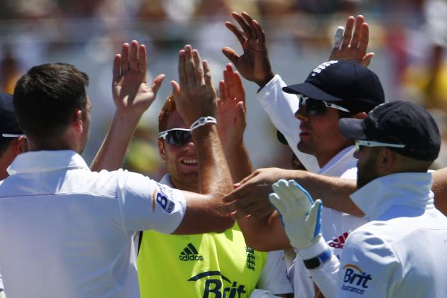England's Anderson celebrates with teammates after taking the wicket of Australia's Smith during the second day of the third Ashes test cricket match in Perth