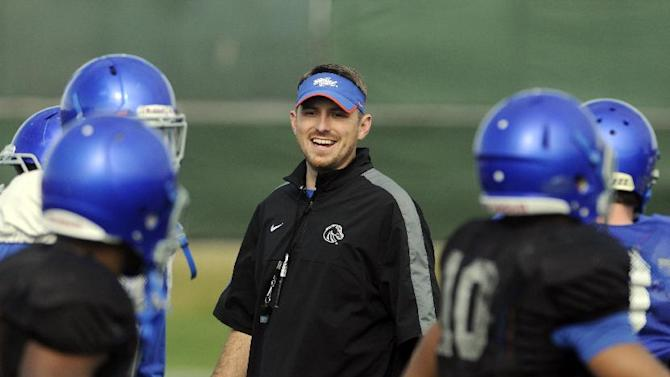 Boise State Offensive Coordinator Mike Sanford smiles during the NCAA college football team's practice for the Fiesta Bowl, Sunday, Dec. 28, 2014, in Scottsdale, Ariz. Boise State is scheduled to play Arizona in the bowl game Wednesday