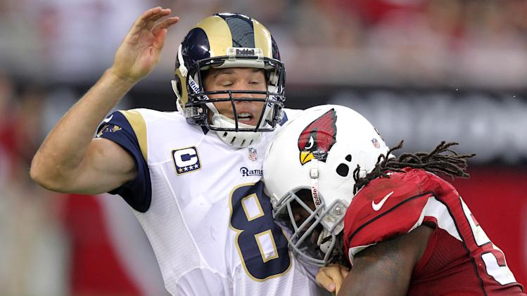 St. Louis Rams quarterback Sam Bradford (8) is hit by Arizona Cardinals outside linebacker Quentin Groves during the first half of an NFL football game, Sunday, Nov. 25, 2012, in Glendale, Ariz. Bradford left the game for one play after the hit. (AP Photo/Paul Connors)