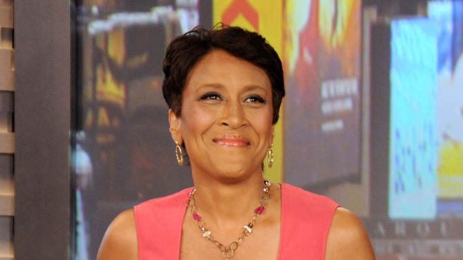 """FILE - This Aug. 20, 2012 file photo released by ABC shows co-host Robin Roberts during a broadcast of """"Good Morning America,"""" in New York. Roberts has thanked her viewers for their support as she faces a bone marrow transplant. The """"Good Morning America"""" co-anchor sent a video message taped from her New York hospital bed for airing on the program Thursday, Sept. 20, which is the day she's set to have the transplant. (AP Photo/ABC, Donna Svennevik, file)"""