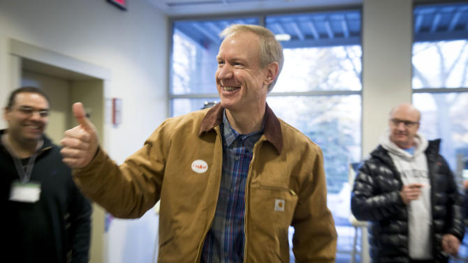 Illinois Republican gubernatorial candidate Bruce Rauner exits the polling place after voting on Tuesday, March 18, 2014, in Winnetka, Ill. Rauner faces State Sen. Bill Brady, State Sen. Kirk Dillard and State Treasurer Dan Rutherford in the primary election. (AP Photo/Andrew A. Nelles)