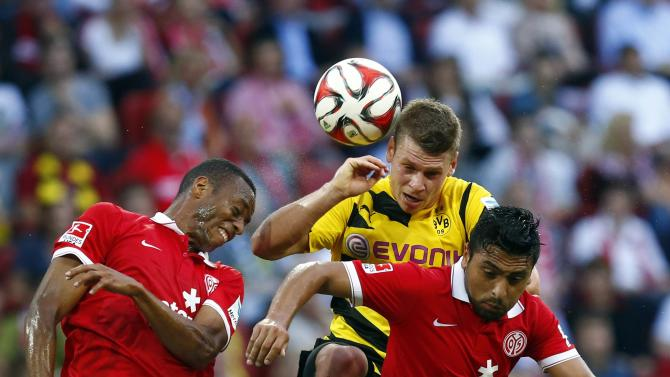 Lukasz Piszcek of Borussia Dortmund fights for the ball with FSV Mainz 05's Junior Diaz and Gonzalo Jara  during their German first division Bundesliga soccer match in Mainz