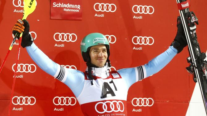 Neureuther of Germany celebrates third place in men's Alpine Skiing World Cup night slalom in Schaldming