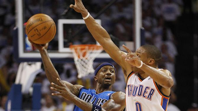 Dallas Mavericks guard Jason Terry, left, throws up a shot in front of Oklahoma City Thunder guard Russell Westbrook (0) at the end of the third quarter of Game 2 in the first round of the NBA basketball playoffs, in Oklahoma City, Monday, April 30, 2012. Oklahoma City won 102-99. (AP Photo/Sue Ogrocki)