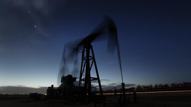 FILE -In this Tuesday, March 6, 2012, file photo taken with a long exposure, a pumping unit sucks oil from the ground near Greensburg, Kan. U.S. oil output is surging so fast that the United States could soon overtake Saudi Arabia as the world's biggest producer.  U.S. production of oil and other liquid hydrocarbons is on track to rise 7 percent in 2012 to an average of 10.9 million barrels per day. It's the fourth straight year of crude increases, and this year drillers are on track to post the biggest single year gain since 1951. . (AP Photo/Charlie Riedel, File)