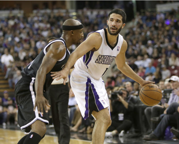 Sacramento Kings guard Greivis Vasquez, of Venezuela, right, dribbles against Brooklyn Nets guard Jason Terry during the fourth  quarter of an NBA basketball game in Sacramento, Calif., Wednesday, Nov
